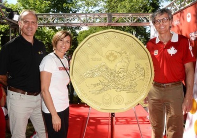 From Left: Royal Canadian Mint Senior Communications Manager Alex Reeves, Isabelle Charest, Assistant Chef de Mission, Canadian Olympic Committee and Gaetan Tardif, President, Canadian Paralympic Committee, unveil the 2016 Lucky Loonie at the Team Canada Beach Party in Toronto on July 1, 2016. (CNW Group/Royal Canadian Mint)