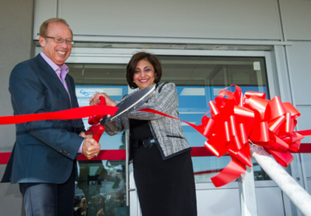 Winnipeg Mayor Sam Katz and Gamma-Dynacare President and CEO Naseem Somani cut the ribbon at a ceremony to mark the official opening of Gamma-Dynacare's new medical laboratory in Winnipeg. The laboratory's employees perform and report about eight million medical diagnostic tests annually at the King Edward Street facility, serving about 2,000 healthcare providers and their patients. (CNW Group/Gamma-Dynacare Medical Laboratories)