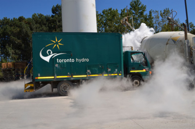 Parked next to a cement  mixer, a Toronto Hydro truck is engulfed by fog caused by the reaction of liquid nitrogen and warm outside air.  Liquid nitrogen is used to keep cement cool to prevent premature curing. Toronto Hydro was onsite conducting inspections for new service connections. Electrical connection requests have increased by approximately 127 per cent from 2003 (CNW Group/Toronto Hydro Corporation)