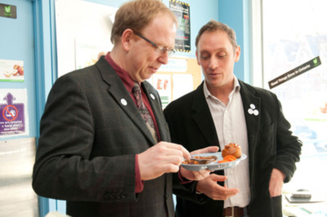 Burkhard Mausberg, CEO, The Greenbelt Fund and David Farnell, Founder, Real Food for Real Kids sampling a local Ontario food meal to be served at public institutions, like Scarborough Hospital. (CNW Group/Greenbelt Fund)