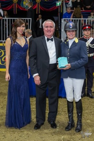 Leslie Howard of the United States was presented with a Tiffany horseshoe pendant as winner of the newly-introduced Tiffany & Co. Leading Lady Rider Award. Photo by Ben Radvanyi Photography (CNW Group/Royal Agricultural Winter Fair)