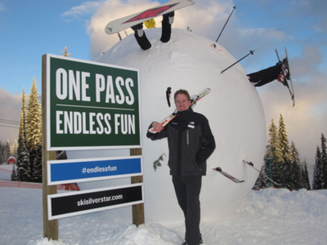 Marke Dickson in front of the World's largest snowball adorned with skis, boards and hockey sticks. (CNW Group/Silver Star Mountain Resort)