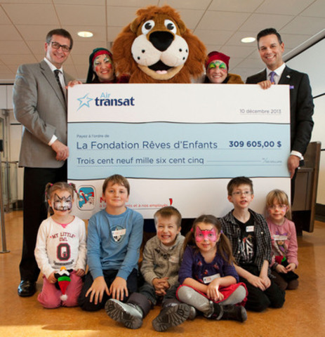 Air Transat gave a cheque for $309,605 to the Children's Wish Foundation today. From left to right: Jean-François Lemay(General Manager, Air Transat), Roary the mascot, flanked by two elves, and Eric Gareau (Children's Wish Foundation). (CNW Group/Transat A.T. Inc.)