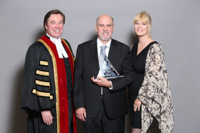 Law Society Treasurer Thomas G. Conway (left) and Marni Beal-Alexander (right), congratulate London lawyer Nigel G. Gilby, on receiving the Law Society's 2014 Lincoln Alexander Award at the Law Society's annual award ceremony on May 21. (CNW Group/The Law Society of Upper Canada)