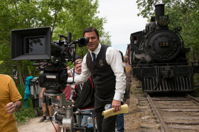 """Yannick Bisson (""""Detective Murdoch"""") on location at the South Simcoe Railway in Tottenham, Ontario. (CNW Group/Shaftesbury)"""