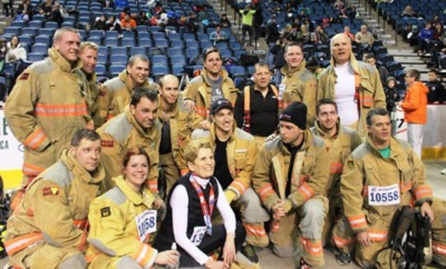 122nd Around the Bay Road Race in support of St. Joseph's Healthcare Foundation - Premier Kathleen Wynne with Hamilton Firefighters who raised over $5,700 for St. Joseph's Healthcare Hamilton and ran the 5K in their gear. (CNW Group/St. Joseph's Healthcare Foundation)