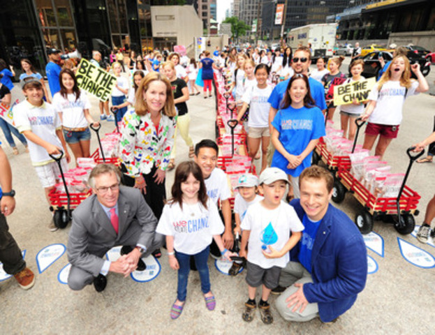 """Gord Nixon, president and CEO of RBC, Jennifer Tory, regional president, Greater Toronto Region, RBC, and Free The Children Co-Founder Marc Kielburger, together with students who helped raise $1.4 million for the """"We Create Change"""" campaign. The Free The Children/RBC initiative will provide a permanent source of clean water to 56,000 people in developing countries. (CNW Group/RBC)"""