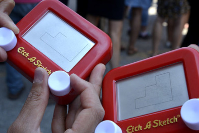 Spin Master employees in Toronto, New York, Los Angeles and Mexico City secured a GUINNESS WORLD RECORDS title for Most People Drawing on an Etch A Sketch Globally. Spin Master acquired the iconic toy brand earlier this year. (CNW Group/Spin Master)