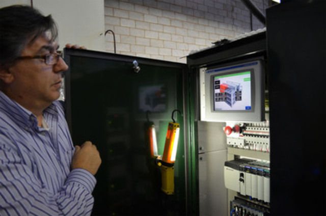 At the control panel of the community energy storage unit, Leo Canale, technical director at eCamion, does some preliminary tests. With 48 battery units, it is capable of powering a small street for one hour. Toronto Hydro plans to monitor this technology, and validate its benefits to Toronto's electrical grid. (CNW Group/Toronto Hydro Corporation)