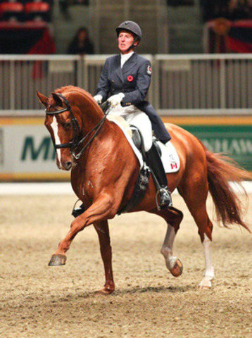 Diane Creech and Devon L had presence and expression to spare, taking first place in tonight's $20,000 Royal Invitational Dressage Cup Freestyle at the Royal Horse Show. Photo credit: Ben Radvanyi (CNW Group/The Royal Agricultural Winter Fair)
