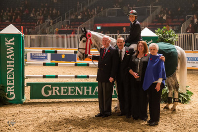 """""""Jill Henselwood and Farfelu du Printemps are presented as the winners of the opening round of competition in the $100,000 Greenhawk Canadian Show Jumping Championship on Friday, November 6, at the Royal Horse Show® in Toronto, ON."""" Photo by Ben Radvanyi Photography, www.benradvanyi.com (CNW Group/Royal Agricultural Winter Fair)"""