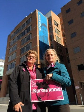 Ontario Nurses' Association (ONA) President Linda Haslam-Stroud, RN (left) and First Vice-President Vicki McKenna, RN are shown here in front of a new banner on the ONA Toronto Office. (CNW Group/Ontario Nurses' Association)