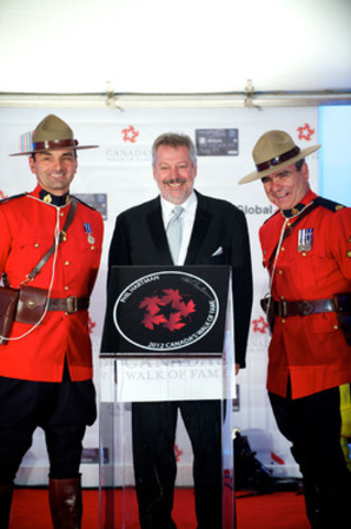 Paul Hartmann receives the Canada's Walk of Fame induction on behalf of his brother Phil Hartman at the Ed Mirvish Theatre in Toronto on Saturday, September 22, 2012. (CNW Group/Canada's Walk of Fame)
