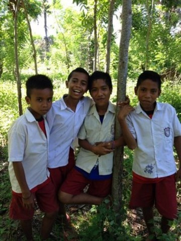 Students in a reforested area, Sumba, Indonesia, May 12, 2015. Farmer-managed natural regeneration (FMNR) mitigates the effects of climate change in developing countries. Photo/World Vision (CNW Group/World Vision Canada)