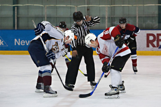 Martin Gelinas and Dennis Polonich faceoff at centre ice during the 2010 CE Franklin 3-on-3 Challenge (CNW Group/CE Franklin Ltd.)