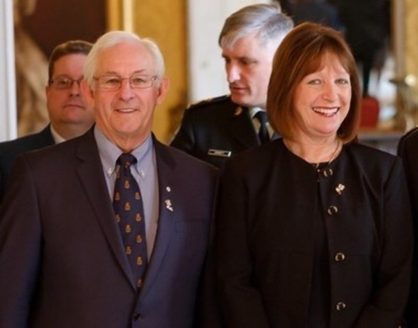 "His Honour Frank Fagan, Lieutenant Governor of Newfoundland & Labrador and Mrs. Patricia Fagan wearing the ""We Remember"" pin featuring certified Anaconda Newfoundland Gold. (CNW Group/Anaconda Mining Inc.)"