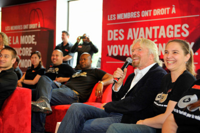 While in Montréal to speak at C2-MTL, Virgin Group founder Sir Richard Branson stopped by the Virgin Mobile flagship store to meet with Québec staff and share his latest global adventures, including Virgin Galactic's first rocket-powered flight test last month (CNW Group/Virgin Mobile Canada)