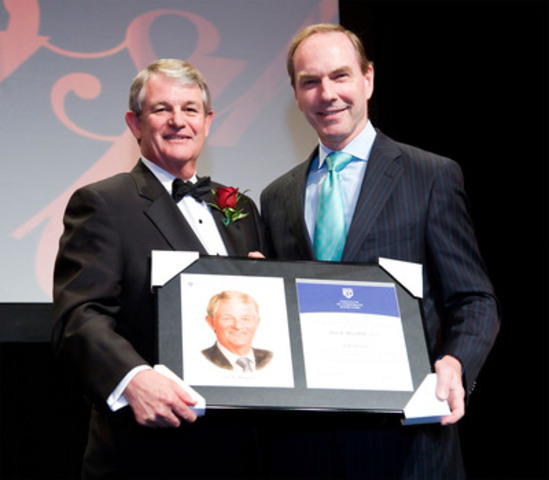 Ian Bourne (left) receives his 2011 ICD Fellowship Award from presenter Bob Astley. (CNW Group/Institute of Corporate Directors (ICD))