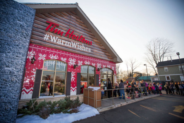 Guests gather at the #WarmWishes kick-off event on November 16 in Grimsby, Ontario to request good deeds for friends and family. (CNW Group/Tim Hortons)