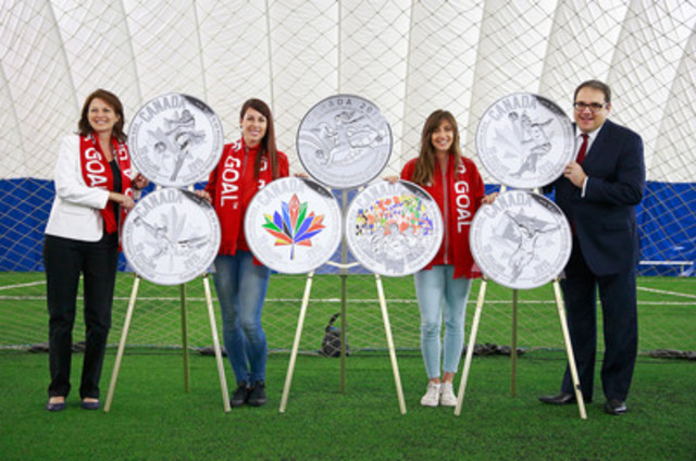From left: Susan Dujmovic, Vice-Chair of the Royal Canadian Mint Board of Directors, Team Canada athletes Emily Zurrer and Selenia Iachelli and Canadian Soccer Association President Victor Montagliani unveil the silver collector coins celebrating the FIFA Women?s World Cup Canada 2015(TM) at The Bubble sports complex in North Vancouver, B.C. (CNW Group/Royal Canadian Mint)