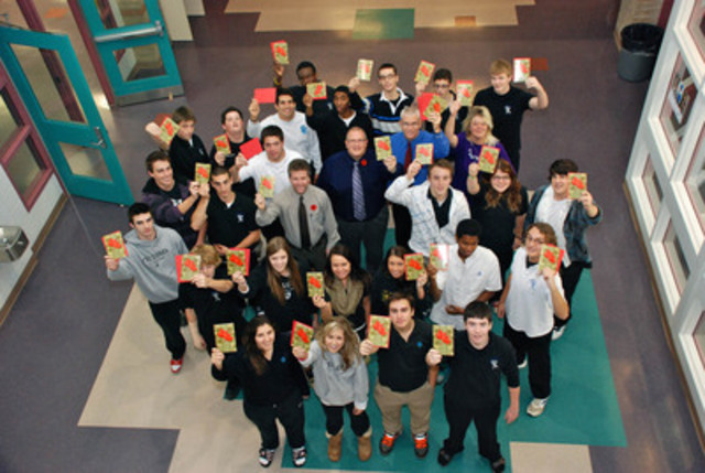 Grade 12 students and staff at St. Christopher Catholic High School in Sarnia raise their Hallmark Everyday Heroes cards that include thoughts and wishes for Canadian troops in Afghanistan. Hallmark Canada donated 900 cards to support the initiative. (CNW Group/Hallmark Canada)