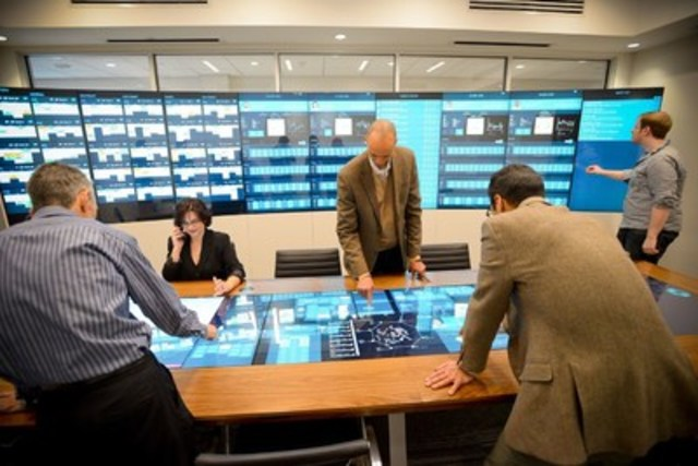 IBMers collaborate through interactive touch screens as part of new IBM Sports Insights Central, designed with cognitive technology to help teams make better decisions. (CNW Group/IBM Canada Ltd.)