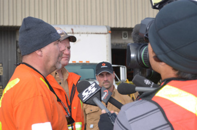Relieved to be home, Toronto Hydro's overhead team members, Rob Milner (left), Gerry Murphy, and John Spina (right), talk about their experiences in the north eastern US helping to restore power following Hurricane Sandy. The company proudly welcomed the first set of crews back earlier today. (CNW Group/Toronto Hydro Corporation)