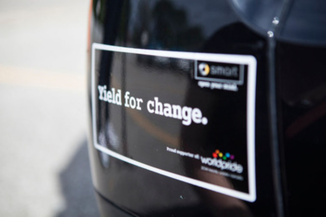 Participants at the smart rally for WorldPride received pride-themed bumper stickers (CNW Group/smart Canada)