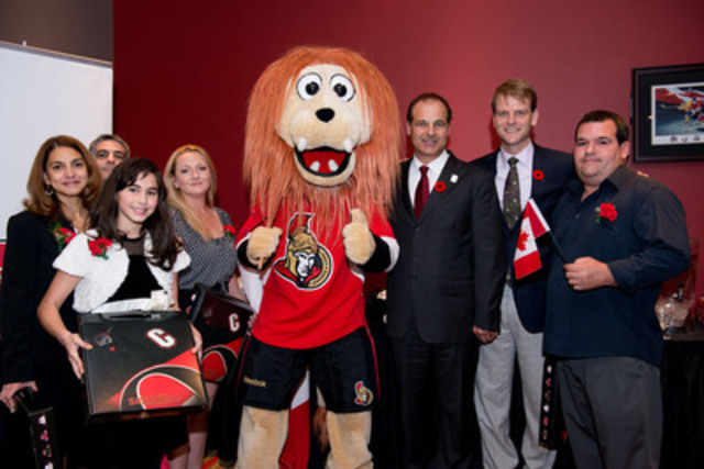 Canada's Citizenship and Immigration Minister Chris Alexander (second from right), Johnny Misley, President, Canadian Tire Jumpstart (third from right), and Ottawa Senators mascot Spartacat participated in the swearing in of 20 new Canadian citizens in the first citizenship ceremony to take place at the Canadian Tire Centre, on Sunday, October 27. The event was the last in a series of cross-Canada celebrations marking Citizenship Week 2013. (CNW Group/CANADIAN TIRE CORPORATION, LIMITED)