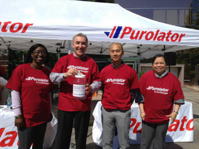 Purolator's President and Chief Executive Officer Patrick Nangle with Purolator volunteers gearing up for Purolator Tackle Hunger Week. (CNW Group/Purolator Inc.)