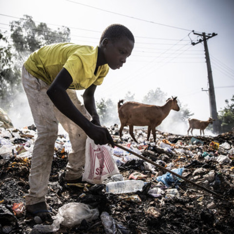 Muhammad Modu, 15, an internally displaced person from Malori, Nigeria, digs through a rubbish dump for saleable items.   © UNICEF/UN016296/Gilbertson (CNW Group/UNICEF Canada)