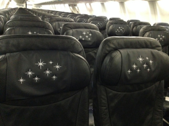 The interior of WestJet's Disney-themed Magic Plane features head rest covers with stars on them. WestJet, WestJet Vacations and Disney Parks & Resorts (Canada) today unveiled a custom-painted Boeing Next-Generation 737-800 series aircraft featuring Sorcerer Mickey on the exterior of the aircraft. (CNW Group/WestJet)
