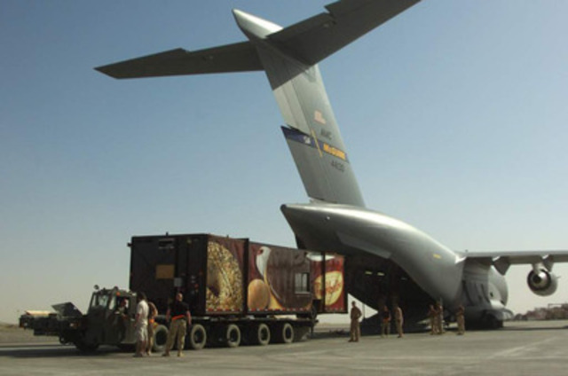 Tim Hortons trailer is seen arriving by military plane at the Canadian Forces operations base in Kandahar, Afghanistan ahead of its opening on Canada Day, 2006. (CNW Group/Tim Hortons Inc.)