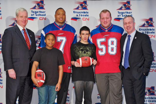 (Left to right) CN Executive Vice-President, Corporate Services and Chief Legal Officer, Sean Finn, 11-year-old Jalen Elbert-Fowlkes, defensive end John Bowman, 16-year-old Dylon Lopes-Alves, centre Luc Brodeur-Jourdain and Alouettes President and CEO, Ray Lalonde. (CNW Group/CN)