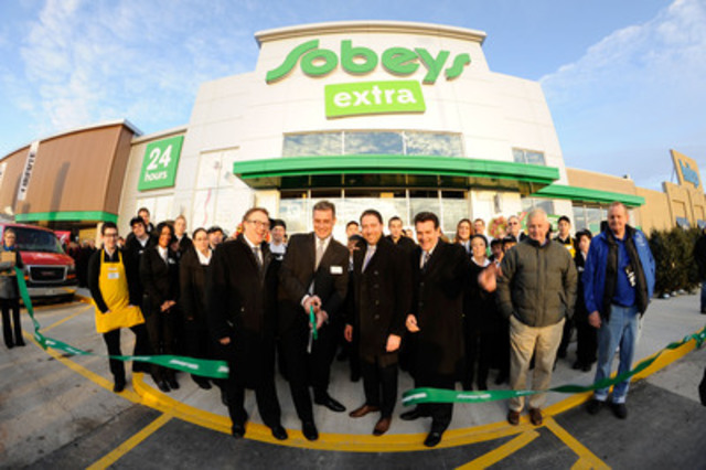 Store manager, Scott Valiquette, cuts the ribbon at the new Sobeys extra Burlington. He is joined by left to ...