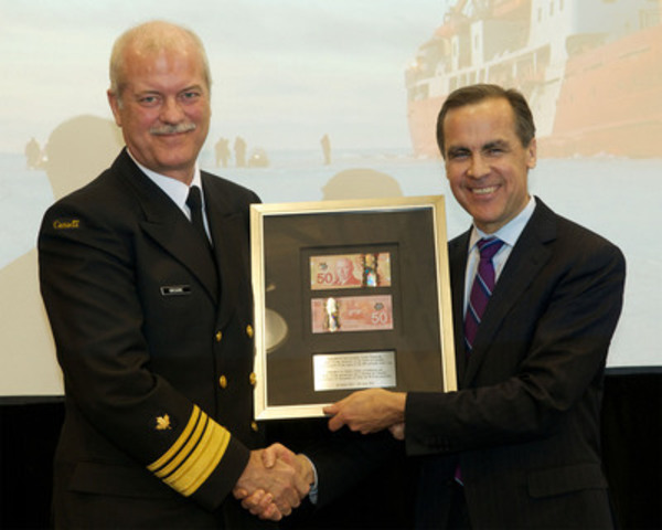 Marc Grégoire, Commissioner of the Canadian Coast Guard, and Mark Carney, Governor of the Bank of Canada, at a ceremony to officially issue Canada's new $50 polymer notes. (CNW Group/Bank of Canada)