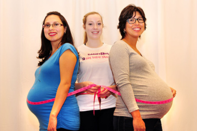 """Aura Plett (left) and Kim Kazumura (right) get their Baby Bumps measured by Caitie McKinnon at Babies""""R""""Us' Big Baby Shower at the BabyTime Show in the Metro Toronto Convention Centre. (CNW Group/Toys """"R"""" Us (Canada) Ltd.)"""