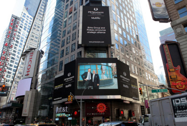 Featuring Rideau's CEO Peter Hart, right, and Jean-Christophe Bédos, President and CEO of Birks Group, an image celebrating the news of the strategic alliance between Rideau Recognition Solutions and Birks Group was on display in New York's Times Square on Aug. 4, 2015. (CNW Group/Rideau Recognition Solutions)