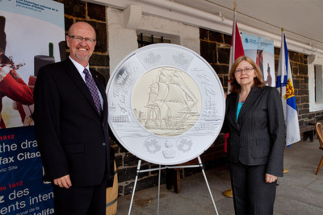 Mr. Kirk MacRae, Member of the Royal Canadian Mint Board of Directors and Halifax artist Bonnie Ross unveil the 2012 two-dollar circulation coin commemorating the 200th anniversary of the War of 1812, designed by Ms. Ross, at the Halifax Citadel National Historic Site (June 18, 2012). (CNW Group/Royal Canadian Mint)