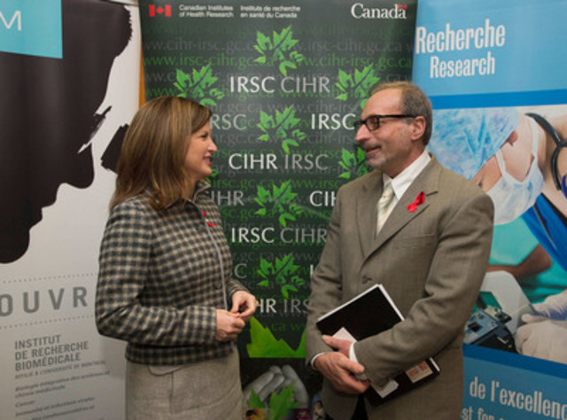 Health Minister Rona Ambrose speaks with Mr. Robert Reinhard, a man living with HIV, following the announcement of funding for research to cure HIV on November 28, 2013 in Montreal. (CNW Group/Canadian Institutes of Health Research)