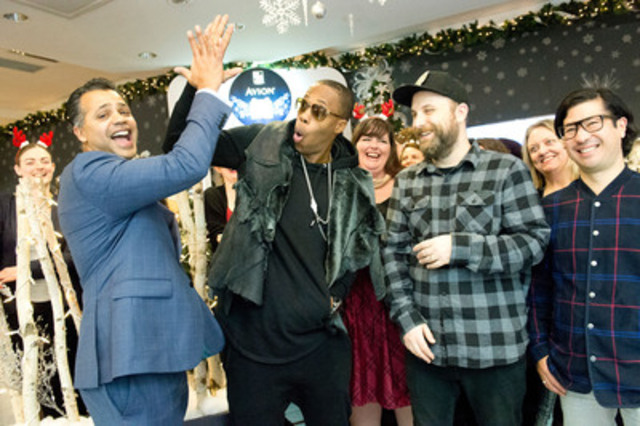 Glenn DeSouza, Vice President, Retail Cards, RBC (L) shares an Avion high five moment at the RBC Avion Holiday Boutique kick-off with Kardinal Offishall (C) and members of Choir! Choir! Choir! (CNW Group/RBC)