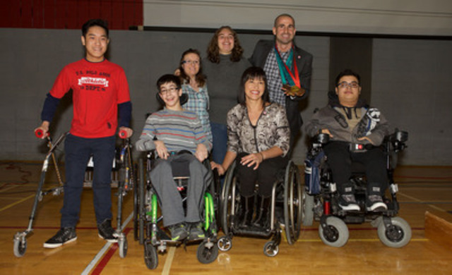 Montreal, March 9, 2015  Canadian Paralympic swimming star Benoit Huot of Montreal received his replacement medals today at a special ceremony held at École Joseph Charbonneau, with students from Marie Enfant Rehabilitation Centre. (CNW Group/Canadian Paralympic Committee (CPC))