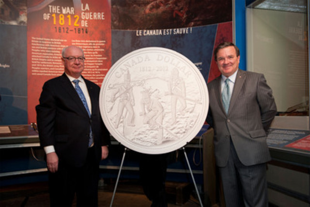 From left to right: Mr. James B. Love, Chair of the Royal Canadian Mint Board of Directors and the Honourable Jim Flaherty, Minister of Finance and Minister responsible for the Royal Canadian Mint unveil the Mint's 2012 Proof Silver Dollar celebrating the 200th anniversary of the War of 1812 at the Canadian War Museum in Ottawa, Ontario (January 17, 2012). (CNW Group/Royal Canadian Mint)