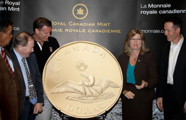 From left to right: Deepak Obhrai, MP (Calgary East); Mark Tewksbury, Canada's Chef de mission for the 2012 Summer Olympic Games; Ian E. Bennett, President, Royal Canadian Mint; Shelley Glover, MP (Saint Boniface) and David Legg, President, Canadian Paralympic Committee unveil the 2012 Lucky Loonie circulation coin at Canada's Sport Hall of Fame in Calgary (July 19, 2012). (CNW Group/Royal Canadian Mint)