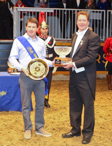 """Ireland's Conor Swail was named the Leading International Rider of the 2013 CSI4*-W Royal Horse Show, Toronto. Presenting the """"Braeburn Farms"""" Leading International Rider award is Brian O'Leary, Horse Show Chairman. (CNW Group/Royal Agricultural Winter Fair)"""