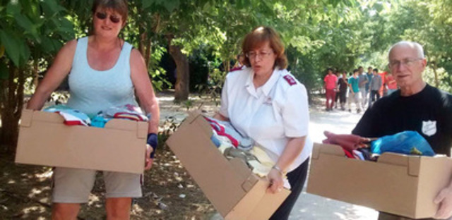 Salvation Army team distributing clothing to refugees in Greece (CNW Group/The Salvation Army)