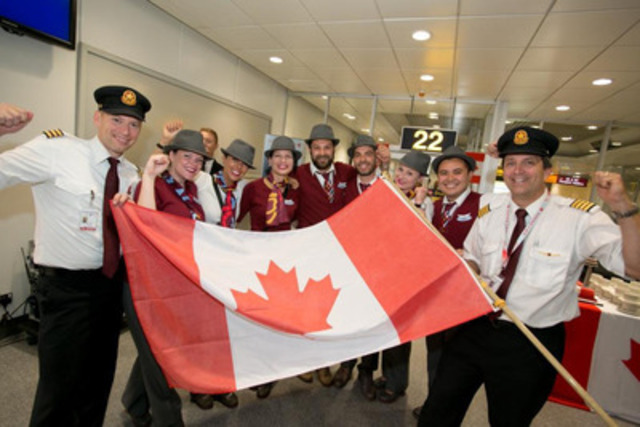 Air Canada rouge Manchester 3 - Air Canada rouge's fun-loving staff celebrate the launch of seasonal Manchester-Toronto service on 27 June 2014 (CNW Group/Air Canada rouge)