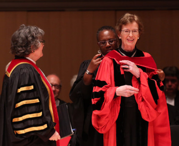 Law Society Treasurer Janet E. Minor (left) watches as Law Society Bencher Joanne St. Lewis places the LLD hood on Her Excellency Mary Robinson at the morning Call to the Bar ceremony on Toronto June 20. A former President of Ireland, Robinson received the honorary LLD from the Law Society in recognition of her  work in the fields of human rights and climate justice. (CNW Group/The Law Society of Upper Canada)