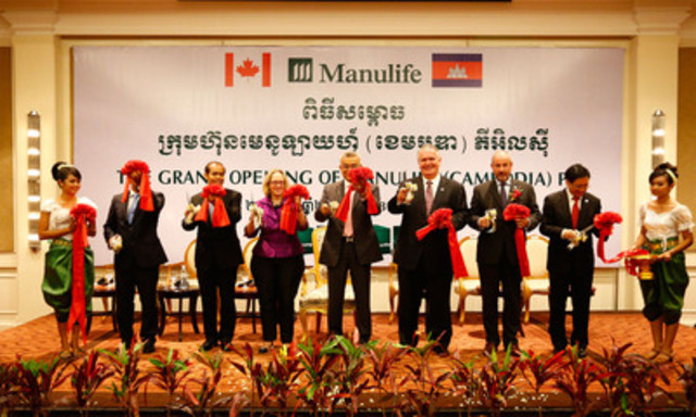 Ribbon cutting ceremony of the Grand Opening. From left to right: 1. Mey Vann, Ministry of Economic and Finance 2. Chou Vichet, Ministry of Economic and Finance 3. Jennifer May, Acting Ambassador of Canada, responsible for Cambodia 4. Dr. Aun Porn Muniroth, Minister attached to the Prime Minister, Secretary of State of Ministry of Economic and Finance 5.Mr. Robert A. Cook, Senior Executive Vice President and General Manager, Asia, Manulife 6. Mr. Philip Hampden-Smith, Executive Vice President and General Manager, South East Asia Operations, Manulife 7. Mr. David Wong, Senior Vice President and Chairman of Manulife (Cambodia) PLC (CNW Group/Manulife Financial Corporation)