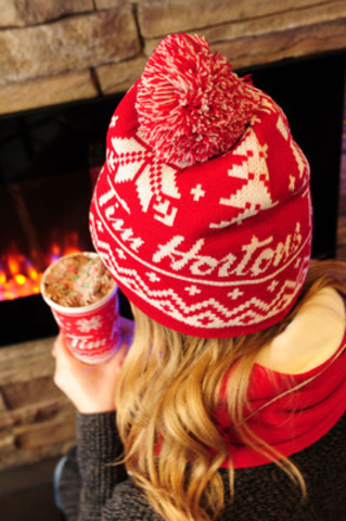 Each time a guest shares a good deed using the #WarmWishes hashtag on Twitter or Instagram, Tim Hortons will pay-it-forward and donate a toque to a child in need through the Tim Horton Children's Foundation. Tim Hortons' goal is to provide to 10,000 children with a warm and cozy toque this holiday season. (CNW Group/Tim Hortons)